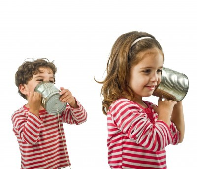 children-talking-and-playing-telephone