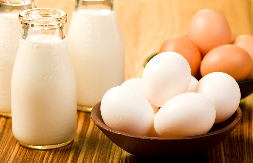 Milk and eggs on wood table